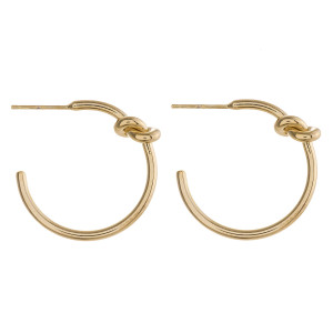 "Hoop earrings featuring a tied knot detail and stud post. Approximately 1"" in diameter."