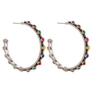 """Western style hoop earrings with natural stone accents. Approximately 2"""" in diameter."""