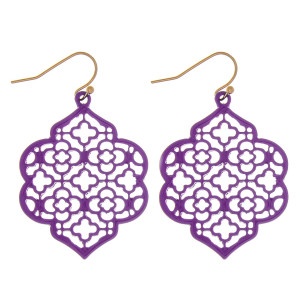 """Metal lotus inspired drop earrings featuring a pattern detail. Approximately 2"""" in length."""
