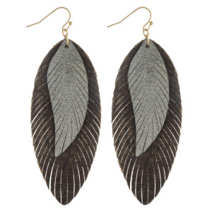 """Double layered feather inspired earrings with cork and metallic details. Approximately 3.5"""" in length."""