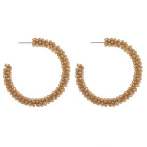 """Faceted beaded hoop earrings. Approximately 2"""" in diameter."""