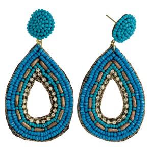 "Seed beaded cut out felt teardrop boho earrings with rhinestone details. Approximately 3"" in length."