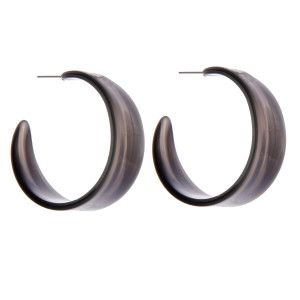 "Wide resin open hoop earrings. Approximately 2"" in diameter, .5"" wide."