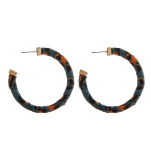 "Leopard print fabric wrapped open hoop earrings. Approximately 2"" in diameter."