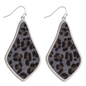 "Leopard print faux fur encased arabesque drop earrings. Approximately 2.5"" in length."