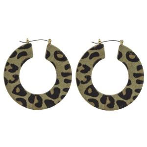 "Leopard print cowhide flat pin catch hoop earrings.   - Approximately 2"" in diameter"