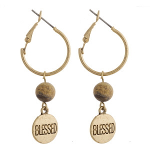"""Gold natural stone """"Blessed"""" engraved dangle hoop earrings. Approximately 1.5"""" in length."""