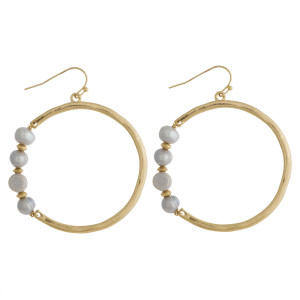 "Hammered freshwater pearl accented dangle earrings. Approximately 2"" in diameter."