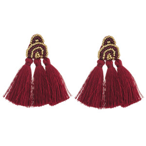 "Seed beaded felt boho tassel earrings. Approximately 2.5"" in length."