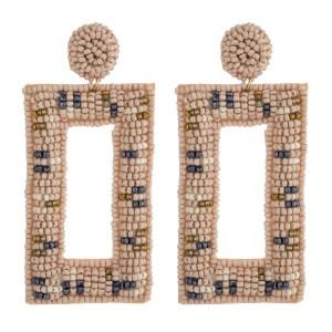 """Seed beaded felt boho drop earrings. Approximately 3"""" in length."""