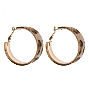 "Faux fur leopard print metal hoop earrings.   - Approximately 1.5""  in diameter - Approximately .5"" wide"