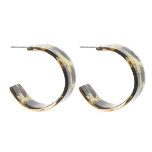 "Leopard print resin open hoop earrings.  - Approximately 1.25"" in diameter"