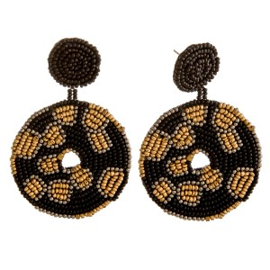 """Seed beaded leopard print felt disc drop earrings. Approximately 2.5"""" in length and 1.75"""" in diameter."""