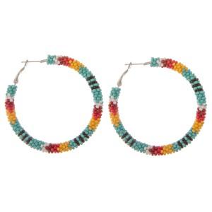 """Seed beaded tribal print hoop earrings.  - Approximately 2"""" in diameter"""
