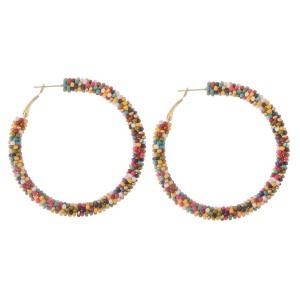 """Mix seed beaded hoop earrings.  - Approximately 2"""" in diameter"""