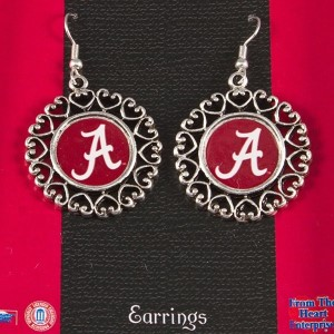 Officially licensed University of Alabama earrings with logo in center circle and framed by connected filigree hearts. Measure 1.5 inches diameter.
