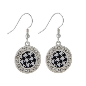 Simple 1 inch round silver toned earrings with a houndstooth print center and a crystal rhinestone border.