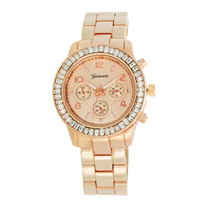 "Rose gold tone metal band watch featuring a 1 1/2"" face with rhinestone rim."