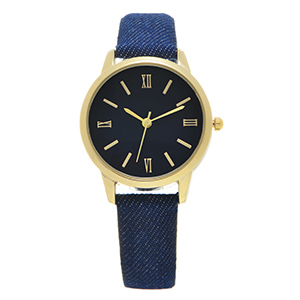 "Blue denim fabric watch band featuring a gold tone 1 1/8"" watch face."