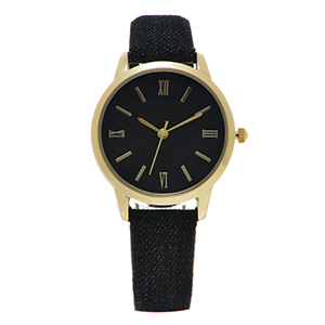 "Black denim fabric watch band featuring a gold tone 1 1/8"" watch face."