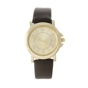 "Brown faux leather watch featuring a gold tone face with Roman numerals. Approximately 9"" in length."