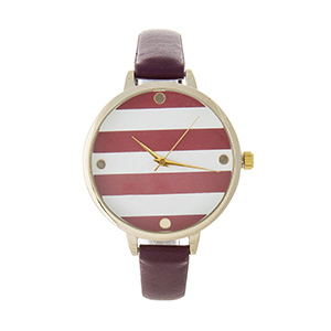 "Maroon faux leather watch featuring a gold tone face with maroon and white stripes. Approximately 9"" in length."