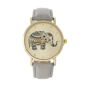 "Gray faux leather watch featuring a gold tone face with a black elephant. Approximately 9"" in length."