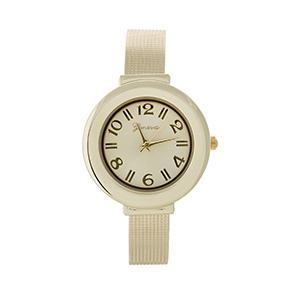 Gold tone cuff watch featuring a texturized metal band.
