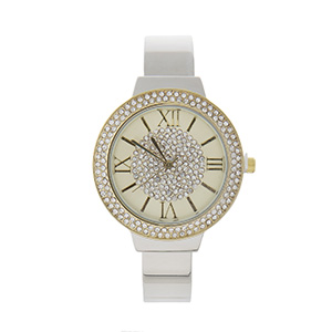Silver tone bange cuff watch with gold tone accented and clear pave rhinestones.