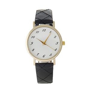 "Quilted black faux leather watch featuring a gold tone face. Approximately 9"" in length."