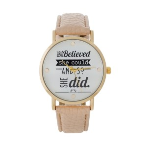 "Beige faux leather watch with a gold tone face that says ""She believed she could and so she did."" Face measures approximately 1.5"" in diameter."