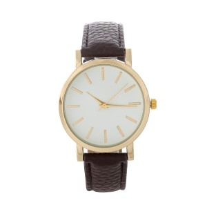 "Brown and gold tone faux leather minimalistic watch. Face measures approximately 1.5"" in diameter."