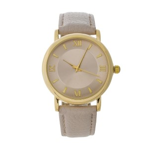 Beige genuine leather watch featuring a beige face and Roman numeral numbers.