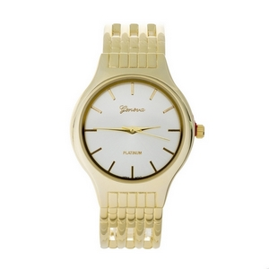 Gold tone cuff watch with a brushed metal face.