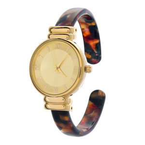 Acrylic, cuff watch with a tortoise pattern and a gold tone face.