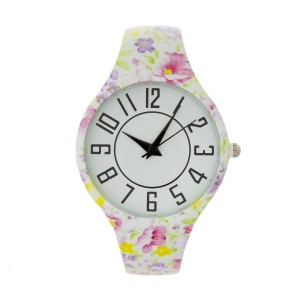 Metal cuff watch with floral design and large numbered face.