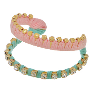 "1 1/2"" Wide, Mint and Pale pink thread wrapped cuff bracelet accented by crystal clear rhinestones and gold tone stud beads."