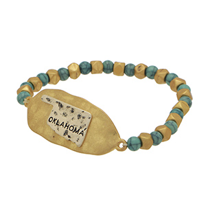 Gold and turquoise tone bead stretch bracelet featuring a gold tone hammered metal focal accented with a silver tone stamped Oklahoma state.