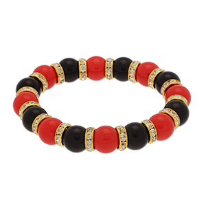 Show off your team spirit with this black/red beaded stretch bracelet accented with crystal clear rhinestones in gold tone beads.