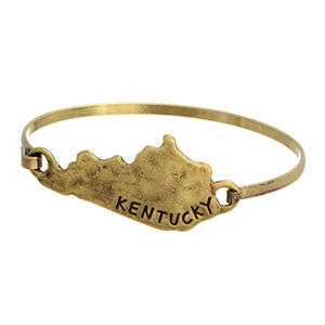 Gold tone burnished bangle with the state of Kentucky focal.