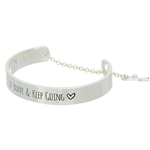 "Silver tone cuff bracelet stamped ""Be brave & keep going."""