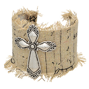 Silver tone cuff bracelet wrapped in fabric featuring a cross focal.