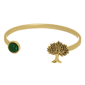 Gold tone cuff bracelet featuring a circle green stone and a tree at the opening.