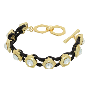 "Black cord bracelet featuring gold tone castings with rhinestone accents. Approximately 6"" in length."