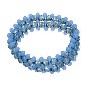 Stretch bracelet featuring blue and navy blue  beads.