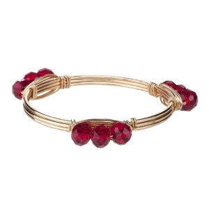 Wire wrapped bangle bracelet with maroon acrylic beads. Made of zinc alloy. Nickel and lead free. One size fits most.