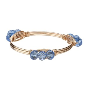 Wire wrapped bangle bracelet with light blue acrylic beads. Made of zinc alloy. Nickel and lead free. One size fits most.