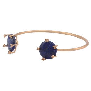 Worn gold tone cuff bracelet featuring two lapis stones with light topaz rhinestone accents.