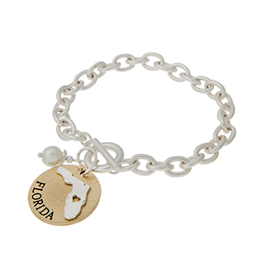 """Matte two tone toggle state bracelet with a """"FLORIDA"""" charm and a faux pearl accent. Approximately 8"""" in length."""