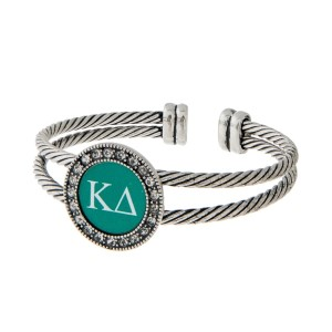 Burnished silver tone officially licensed Kappa Delta cuff bracelet with rhinestone accents.